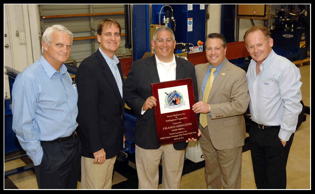Jack Seiler and Chip LaMarca present the 500th Ocean Avenger plaque to Victor Ramos