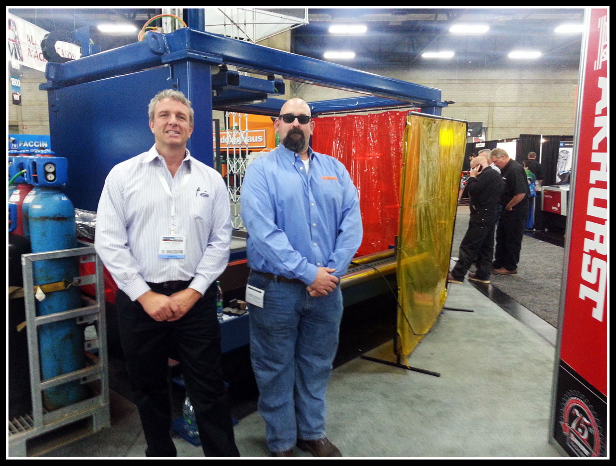 Darryl Thornhill and Jeremy in front of the Ocean Liberator, the worlds fastest selling CNC Beam Coping Machine