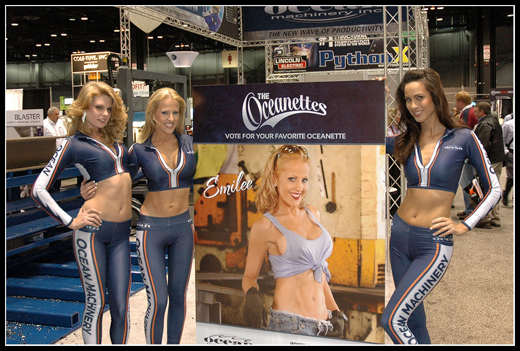 The word famous Oceanettes, Taylor, Emilyand Shannon with a lifesize poster of Emilee, the most popular Oceanette from the 2009 Oceanette Calendar