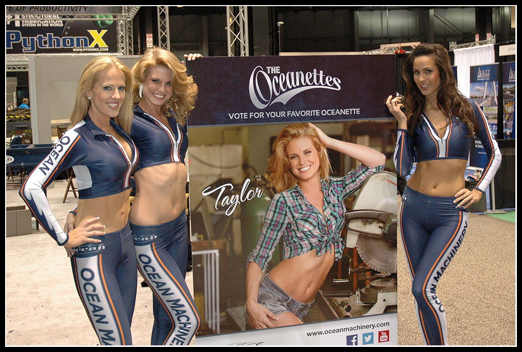 The word famous Oceanettes, Emily Taylor and Shannon with a lifesize poster of Taylor from the 2014 Oceanette Calendar