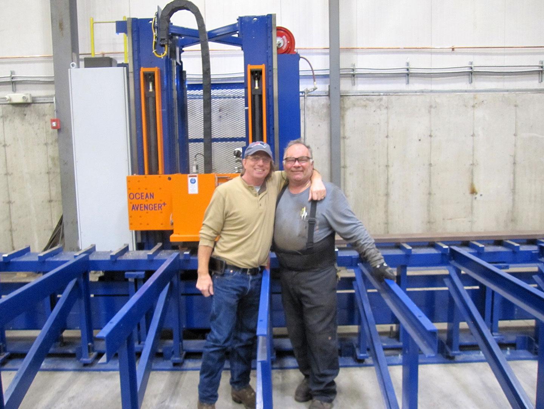 John Evans, Atlantic Machinery, with John Santini, of Santini Brothers Iron Works and their new Avenger PLUS