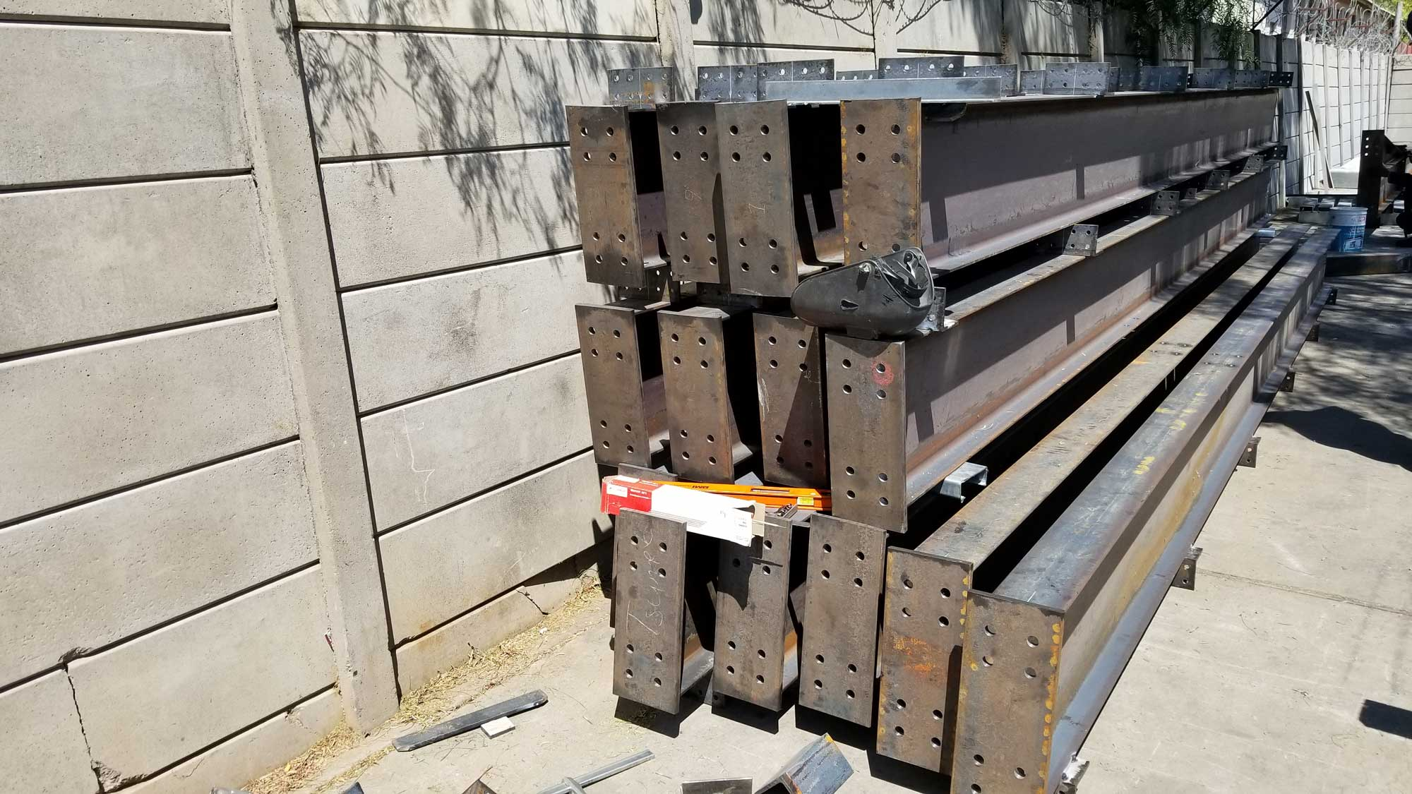 Typical portal steel rafters with connection plates and purlin cleats, all processed on the Ocean Avenger at Invo Stahlbau, Windhoek Namibia