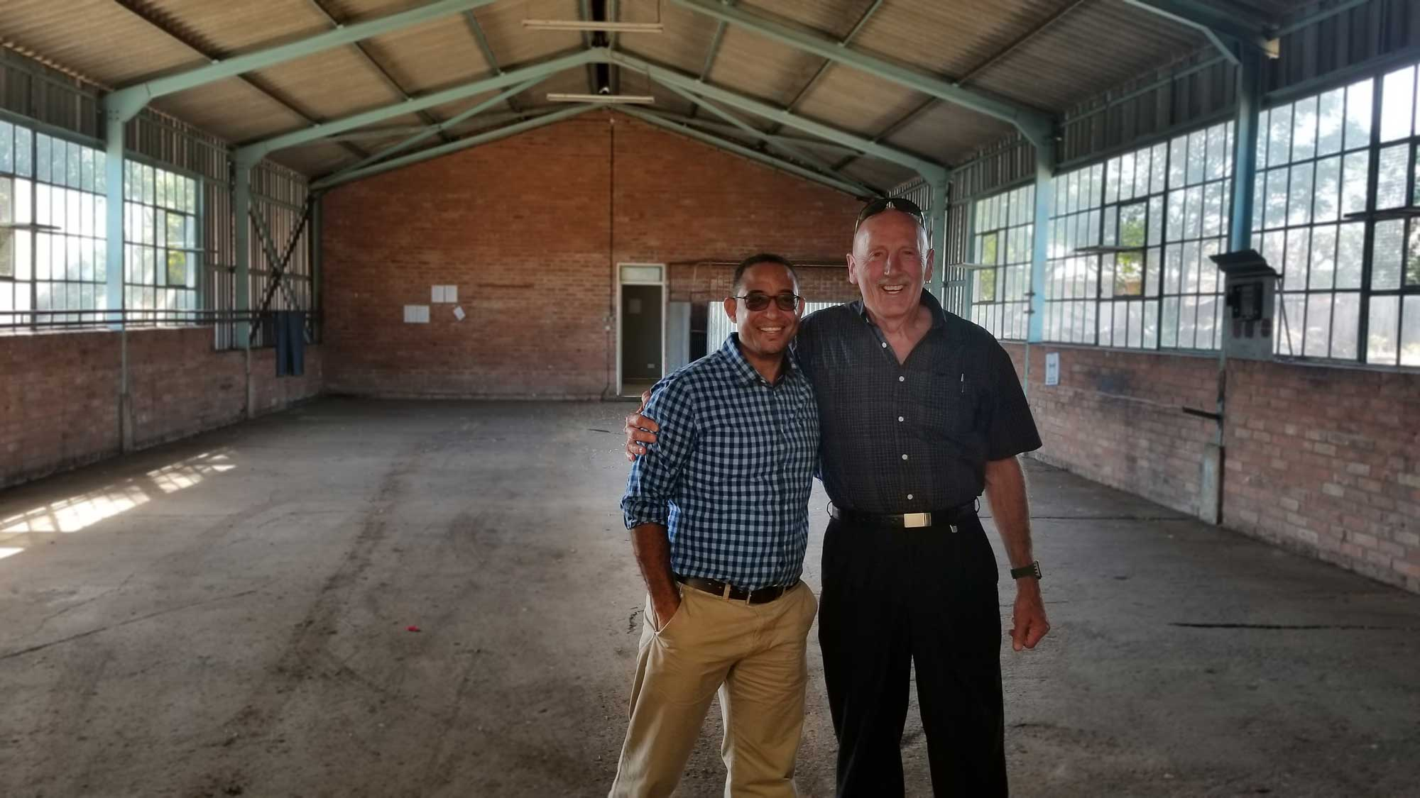 Eugene Jackson (left) - founder of Pump and Steel Supplies, along with Ray Chellew of Skok Machine Tool in the original 2,000sqft building where the journey started