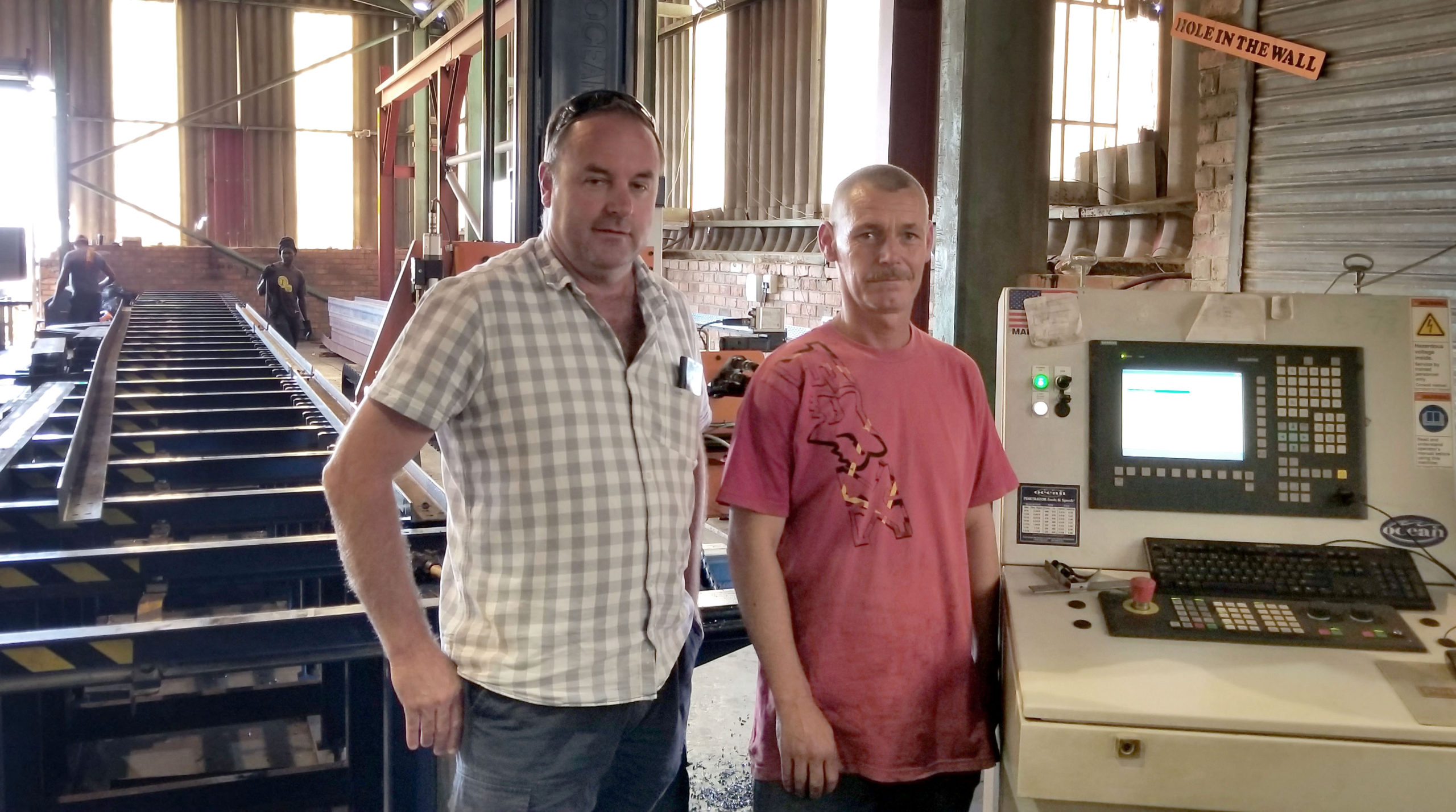 Owner Terry Davies with one of the Avenger Operators, Deon Van Der Merwe, in front of their new CNC drill line, the Ocean Avenger