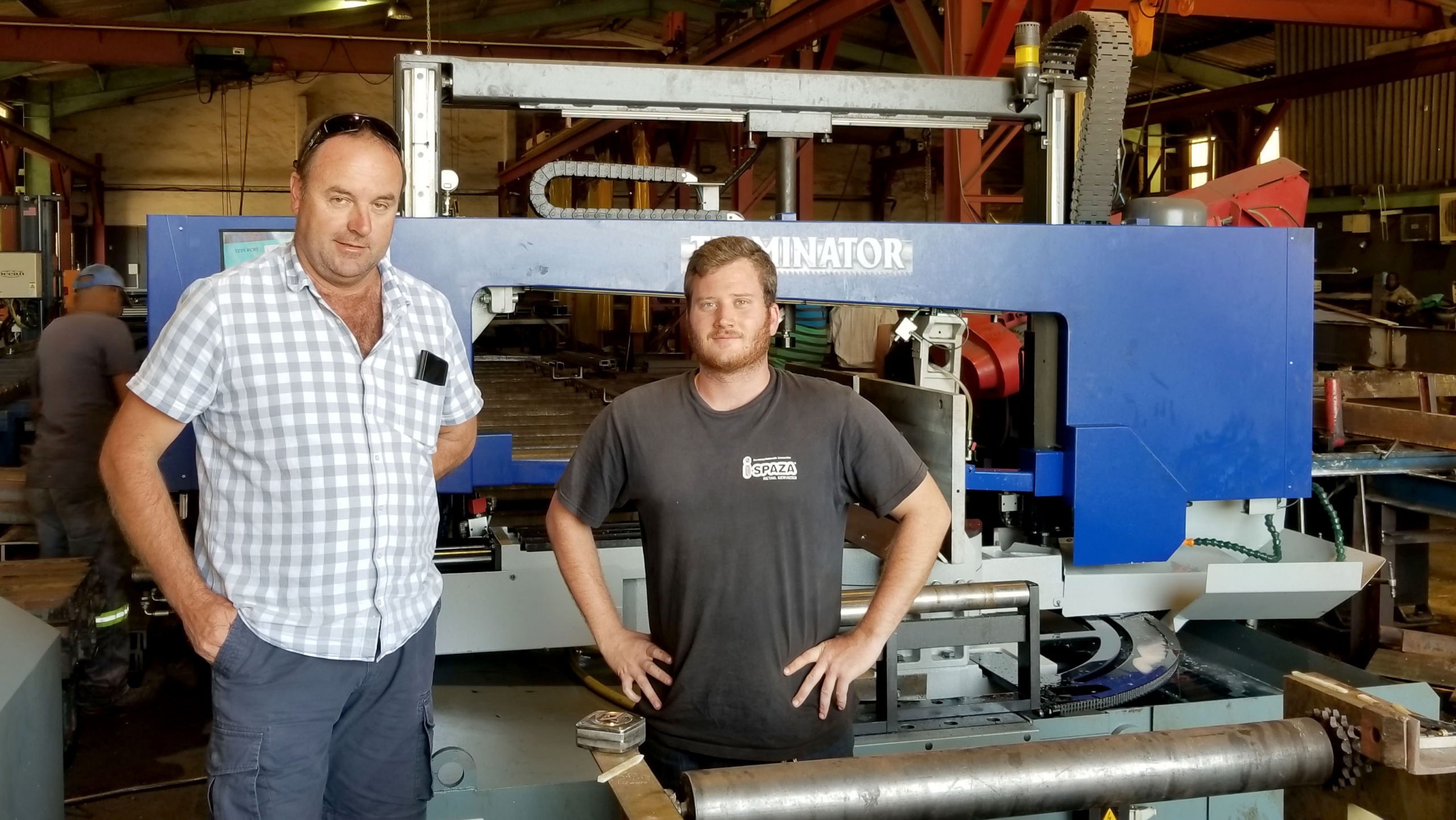 Owner Terry Davies and bandsaw operator Xavier White, in front of their new Ocean Terminator.