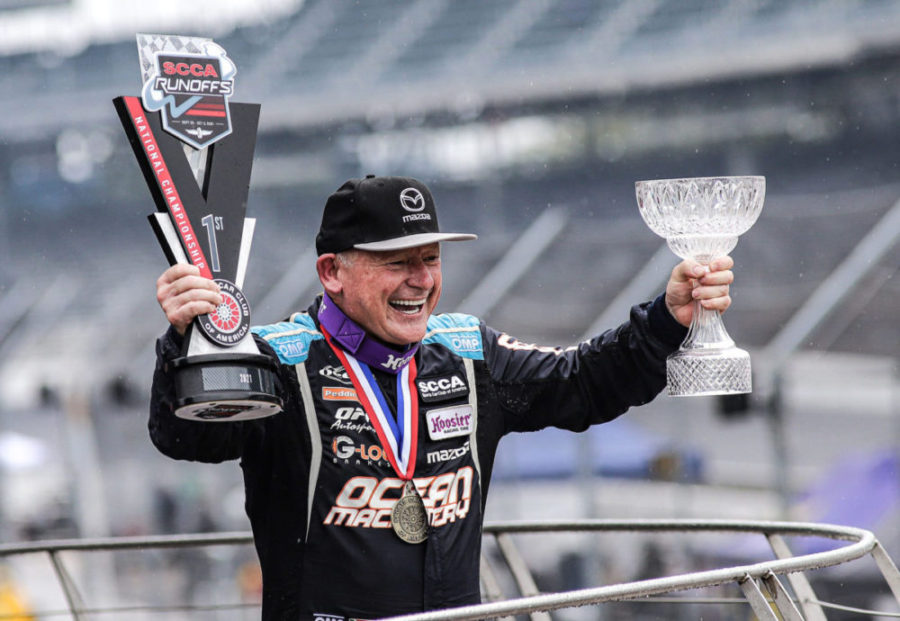 A jubilant Danny Steyn receives the 2021 SCCA Super Touring Lite winners trophy, and the esteemed Super Sweep Award at the Indianapolis Motor Speedway