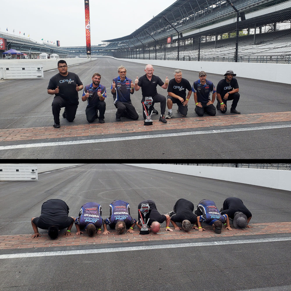 Team OPM Autosports kisses the Yard of Bricks at the famed Indianapolis Motor Speedway, celebrating Danny Steyn's win in the STL class at the 2021 SCCA Runoffs